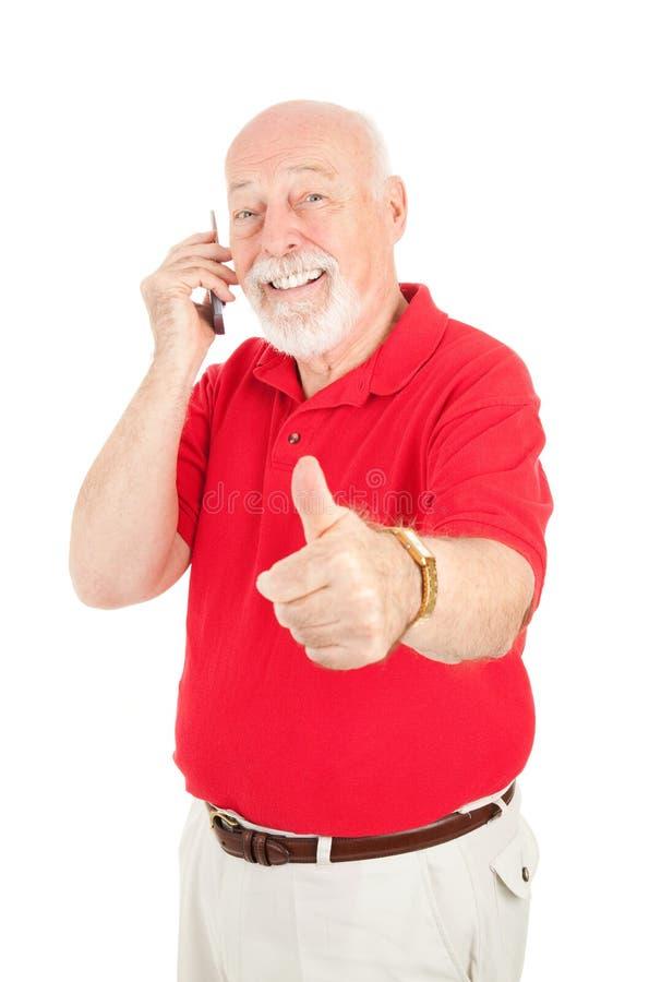 mobiltelefonpensionärthumbsup royaltyfri bild