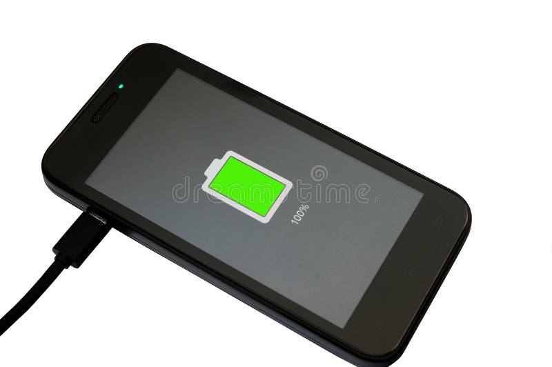 Mobiltelefonuppladdning royaltyfri fotografi