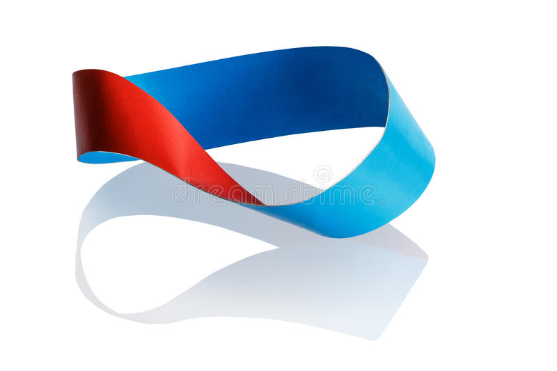 Mobius strip. Has only one face. A line drawn in pencil on the surface will move to the other side and is connected to its beginning stock photos
