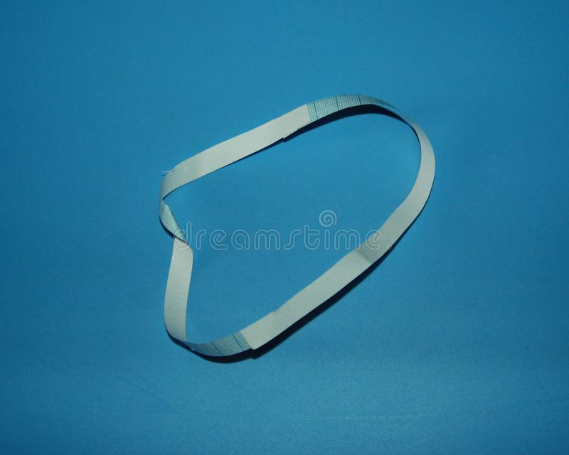 Mobius strip paper ring lies on a table.  royalty free stock images