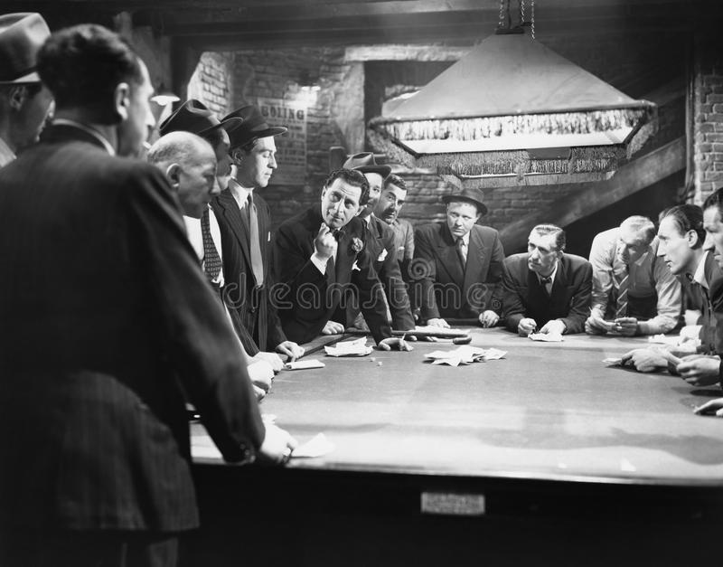 Mobsters meeting around pool table royalty free stock photography