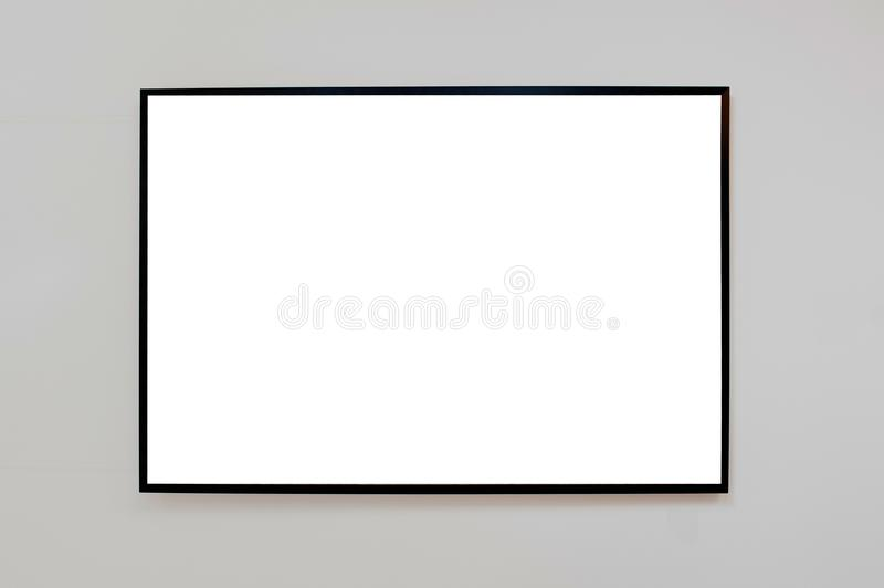 Moc up black frame for picture, advertisement or poster on a gr royalty free stock image