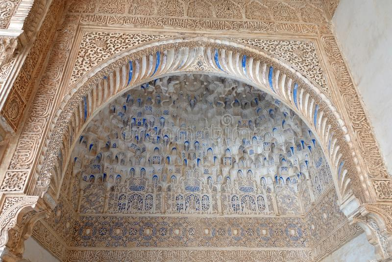 Mocarabes decorated arch at Nasrid palace  at the Alhambra in Granada, Andalusia. Mocarabes styled arch  at the Nasrid palacio royalty free stock photos