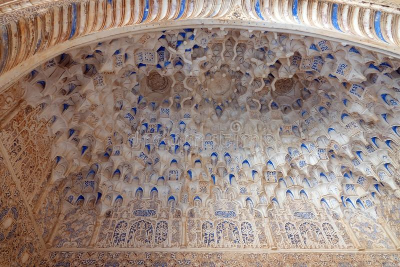 Mocarabes decorated ceiling at Nasrid palace  at the Alhambra in Granada, Andalusia. Mocarabes styled arch  at the Nasrid palacio stock photo