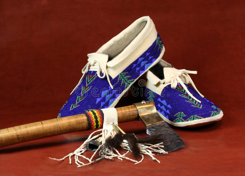Moccasins and Tomahawk. Native American Beaded Moccasins and Tomahawk stock photography
