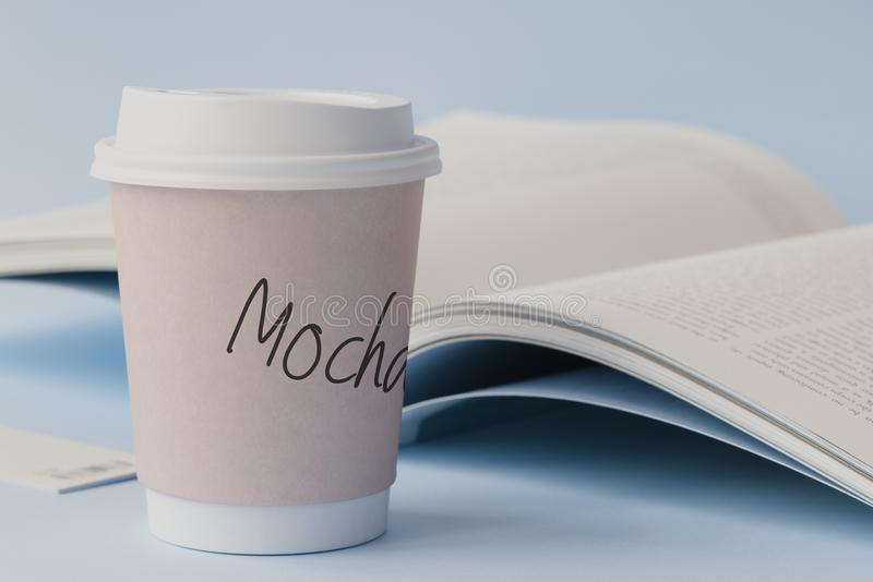 Mocha Labeled White Disposable Coffee Cup Beside Book royalty free stock photos