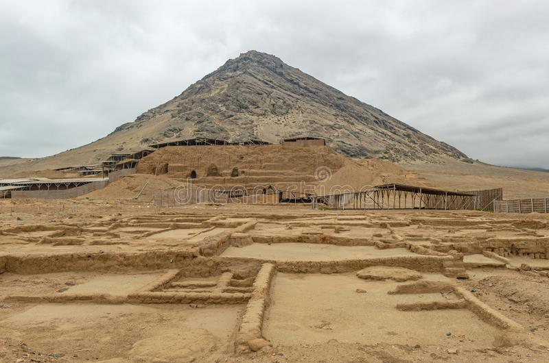 Moche Moon Pyramid, Trujillo, Peru. The Moche or Mochica archaeological site of the Huaca de la Luna or Moon Pyramid build in adobe bricks in front of a mountain royalty free stock image
