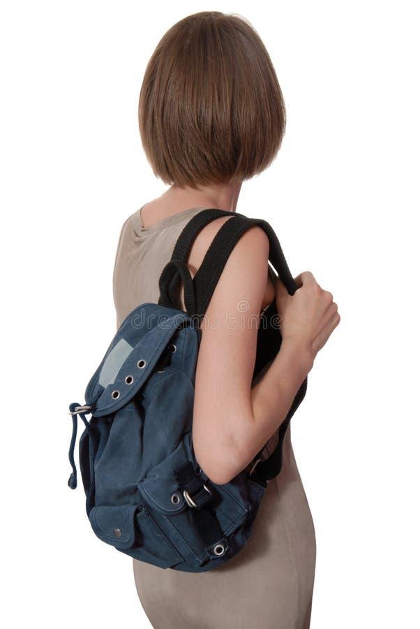 A mochila azul está na mulher imagens de stock royalty free
