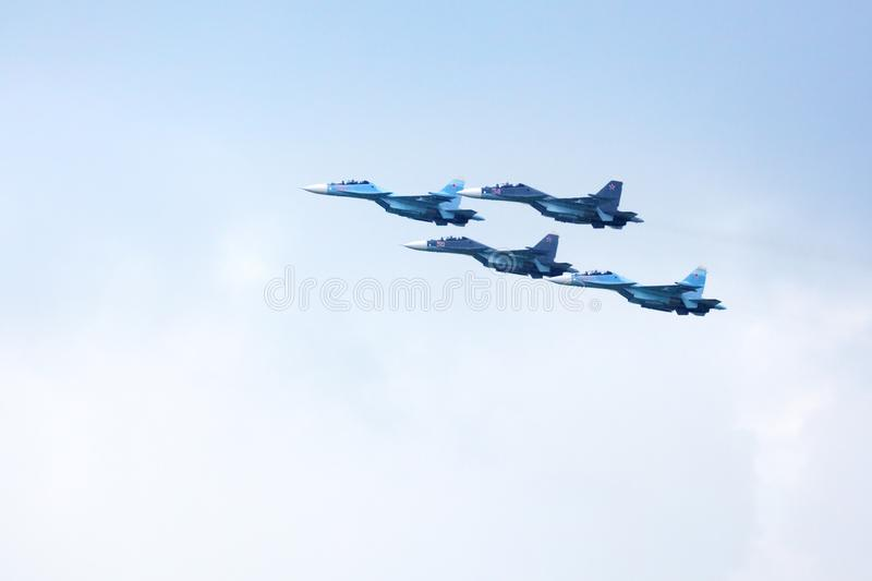 Mochishche airfield, local air show, Aerobatic team VKS `Russian Falcons` Su-30 SM, russian fighter aircrafts in the blue sky stock images