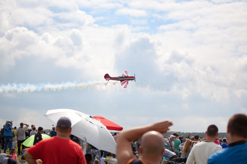 Mochishche airfield, local air show, yak 52 on blue sky with clouds background and many viewers, people watch aviashow stock images