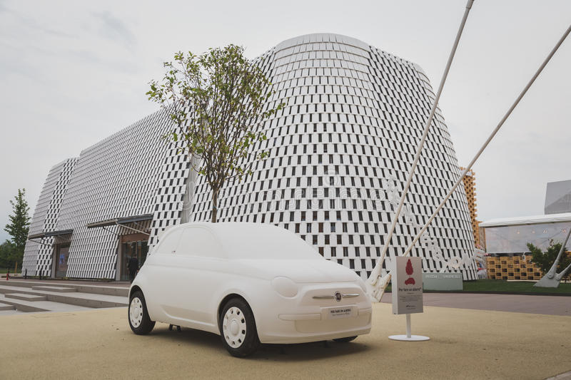 Mock Fiat 500 car at Expo 2105 in Milan, Italy. MILAN, ITALY - MAY 19: Mock Fiat 500 car on display at Expo, universal exposition on the theme of food on MAY 19 royalty free stock images