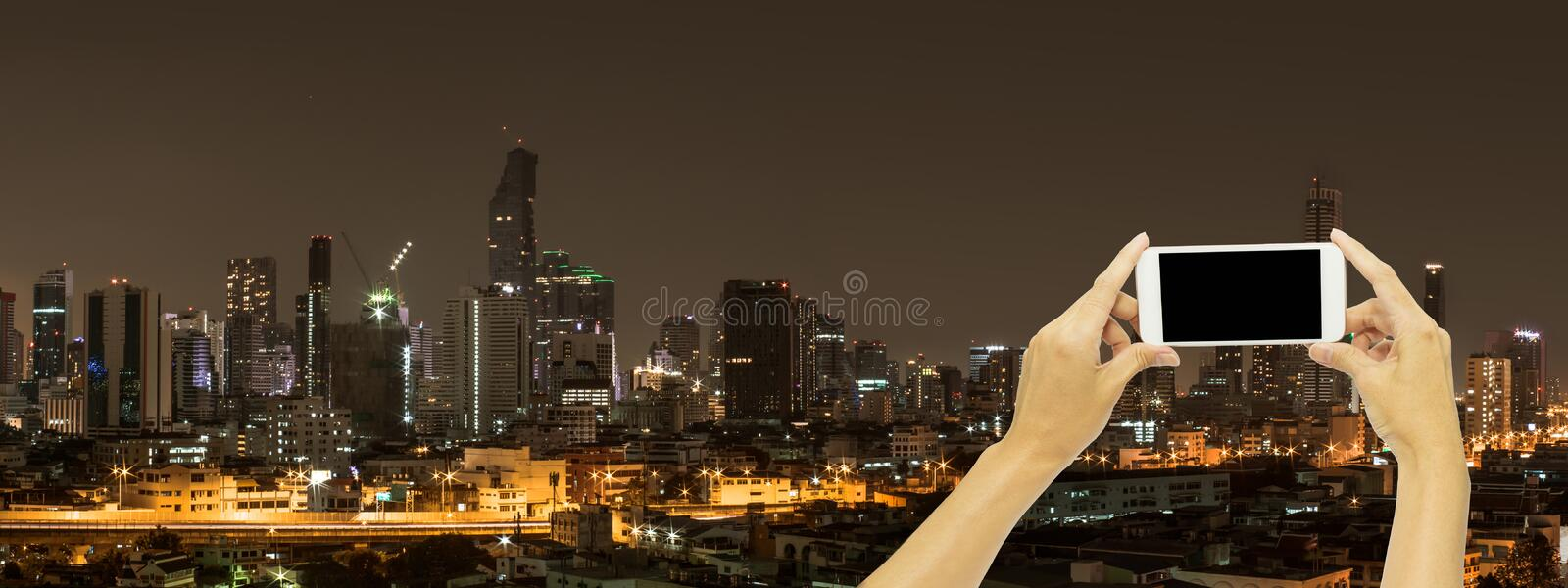 Mock up for advertising with Bangkok building at night time stock image