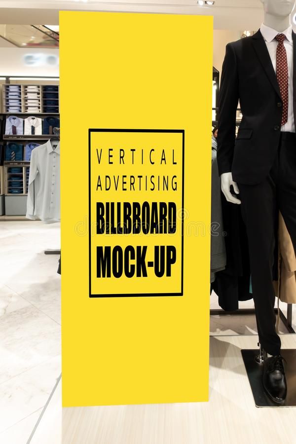 Mock up advertising billboard at suit and clothing shop. Mock up vertical blank billboard with clipping path to show promotion or discount in men& x27;s suit and stock image