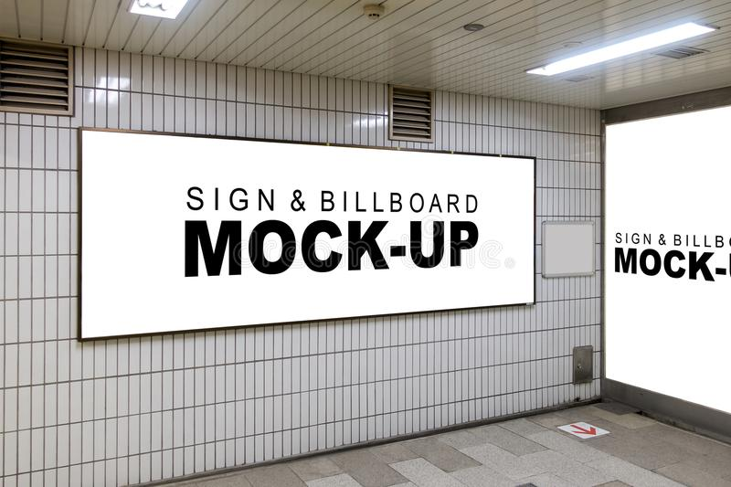 Mock up the Advertising signboard in the corner walls. The mock up the advertising signboard in the corner walls with clipping path, blank white space for indoor royalty free stock photo