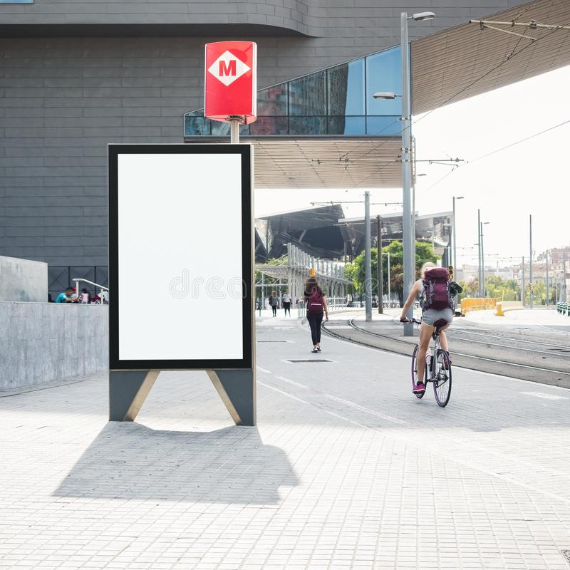 Mock up Banner stand Media outdoor people walking riding bicycle on City street Metro signage stock image