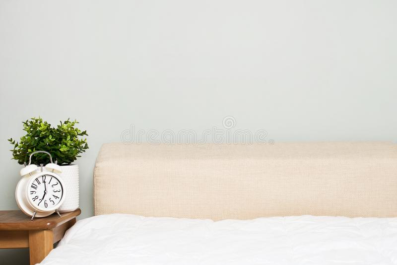 Mock up bedroom empty wall with bed and alarm, morning consept, minimalism, scandinavian stock photo
