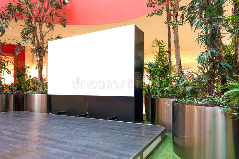 Mock up. Blank billboard, advertising stand in modern shopping mall royalty free stock images