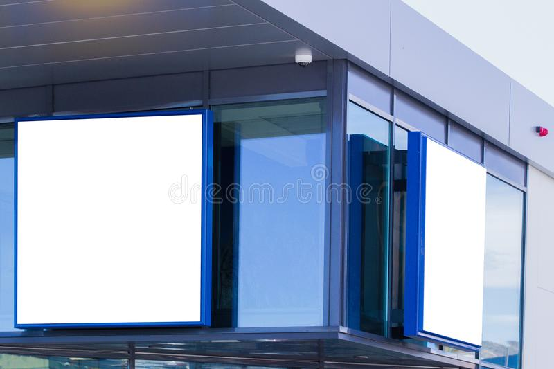 Mock up. Blank billboard outdoors, outdoor advertising, signage on the wall of store, shopping mall royalty free stock photos