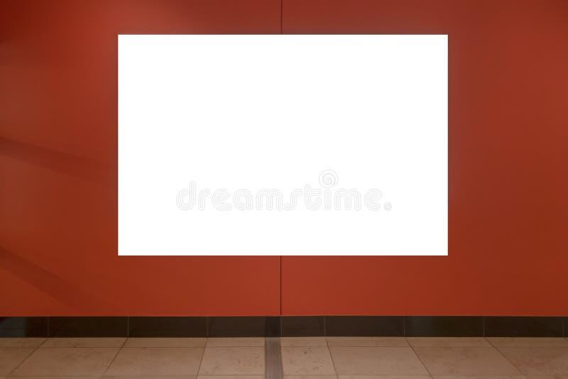Mock up. Blank billboard, poster frame, advertising on the the wall. Mock up. Blank vertical billboard, poster frame, advertising on the the wall royalty free stock image