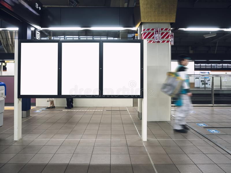 Mock up Blank board Poster in Train station Platform with people walking. Mock up Blank boards Poster in Train station Platform with People walking royalty free stock photo