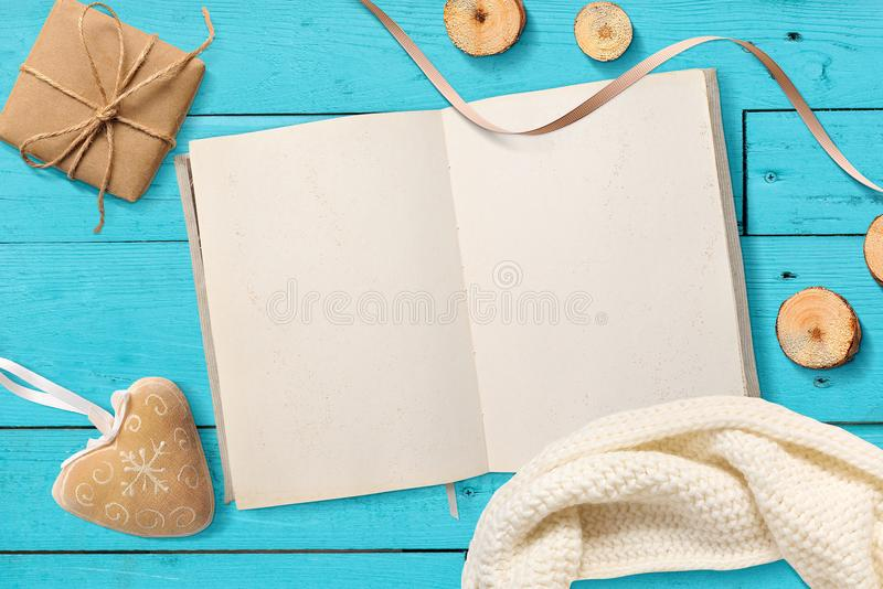 Mock up Blank open Notepad, Christmas gifts on a turquoise wooden background with space for your text royalty free stock photo