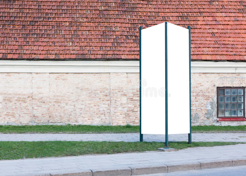 Mock up. Blank outdoor advertising column outdoors, public information board in the street. stock photo