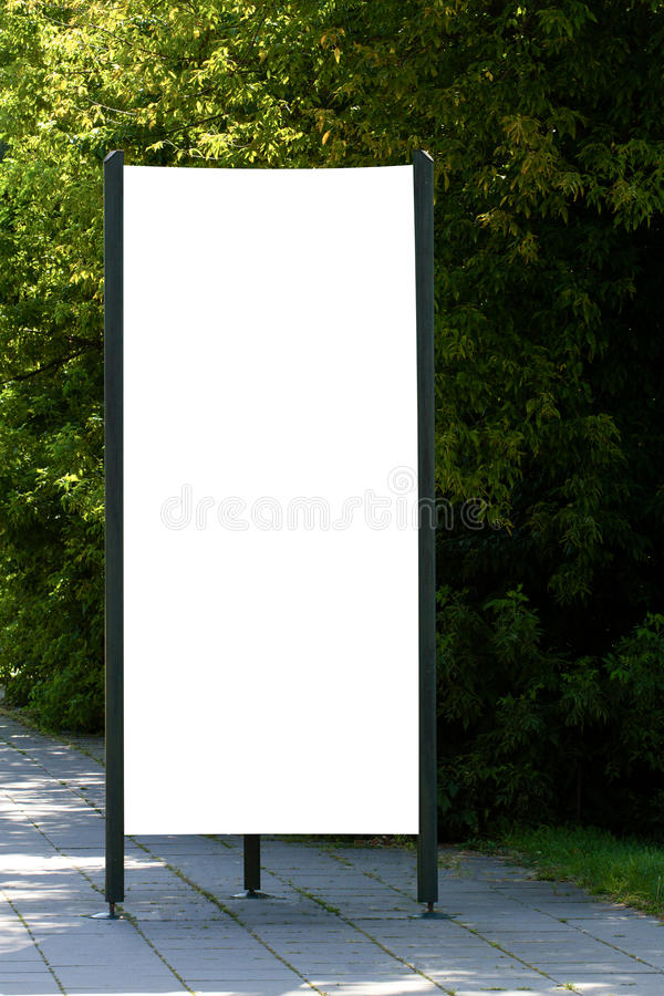 Mock up. Blank outdoor advertising column outdoors, public information board in the street. royalty free stock photos