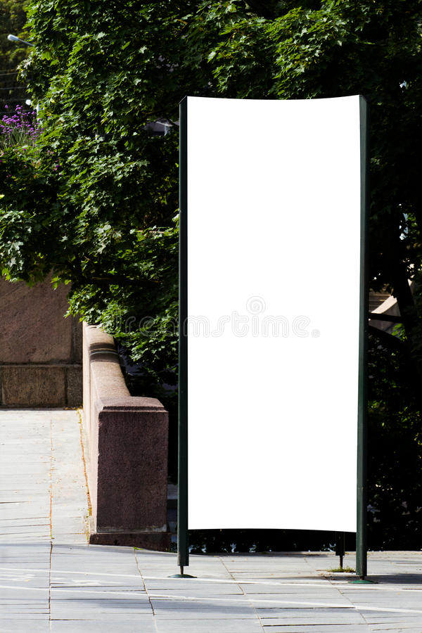 Mock up. Blank outdoor advertising column outdoors, public information board in the street. stock images