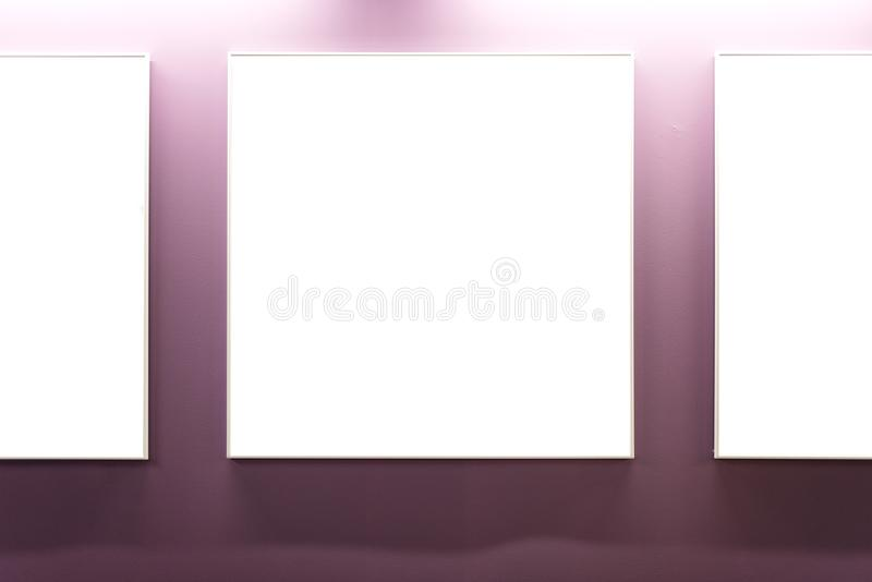 Mock up. Blank picture frames on pink wall in the loft interior. Gallery wall with empty poster frames indoor. Mock up. Blank picture frames on pink wall in the royalty free stock images