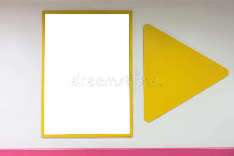 Mock up blank poster frame with yellow frames hanging on wall in shopping mill. Mock up blank advertising poster frame with yellow frames hanging on wall in royalty free stock photos