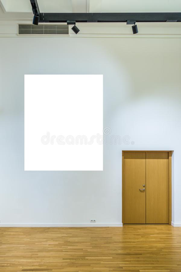 Mock up blank poster in gallery interior.  royalty free stock photo