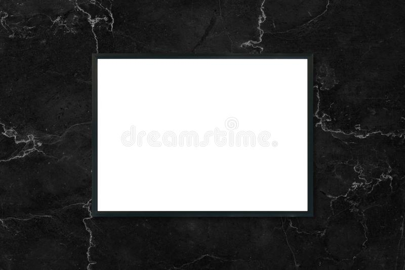 Mock up blank poster picture frame hanging on black marble wall background in room. Mock up blank poster picture frame hanging on black marble wall background stock photography