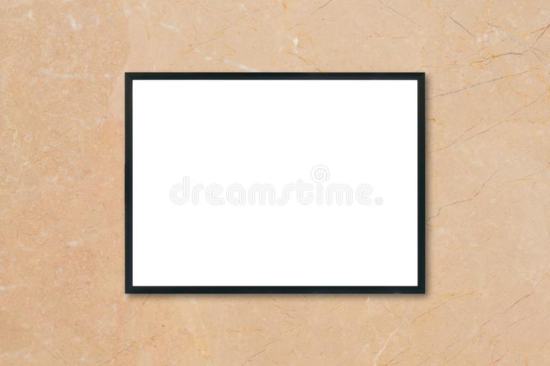 Mock up blank poster picture frame hanging on brown marble wall background in room. Mock up blank poster picture frame hanging on brown marble wall background royalty free stock photos