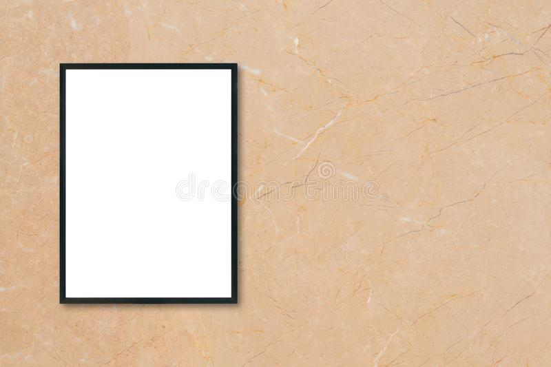 Mock up blank poster picture frame hanging on brown marble wall background in room. stock images