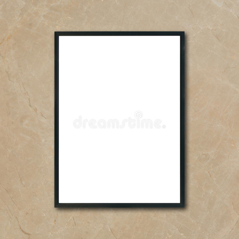 Mock up blank poster picture frame hanging on brown marble wall in room. Can be used mockup for montage products display and design key visual layout royalty free stock photography