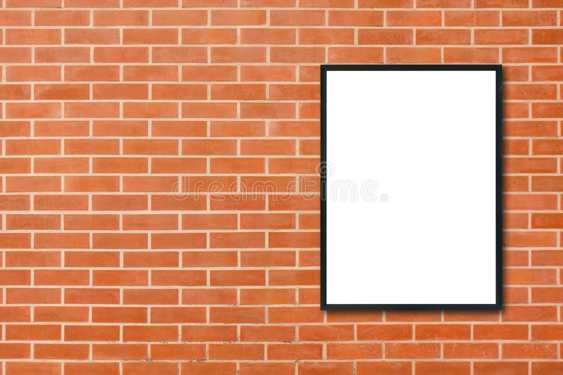 Mock up blank poster picture frame hanging on red brick wall background in room - can be used mock up for montage products display. And design key visual layout stock photos