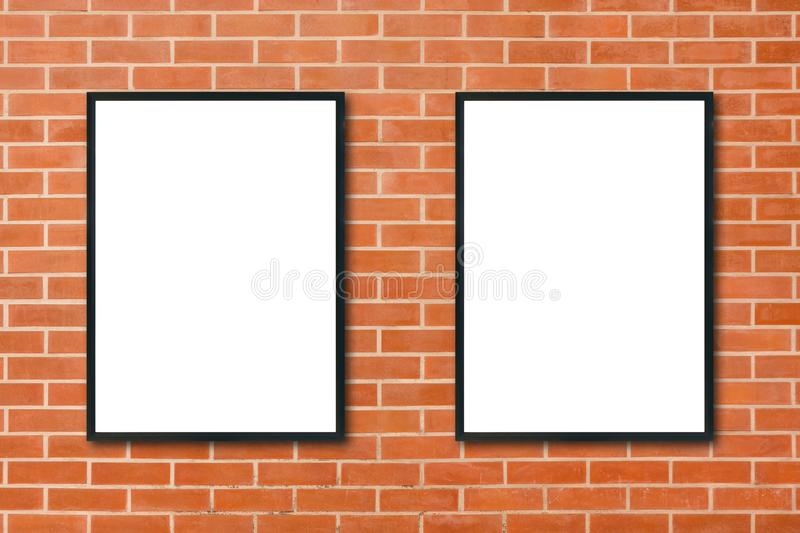 Mock up blank poster picture frame hanging on red brick wall background in room. Mock up blank poster picture frame hanging on red brick wall background in room royalty free stock photography