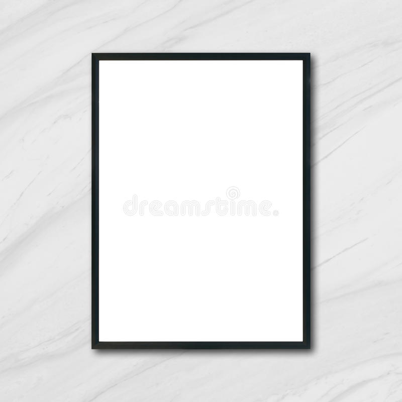 Mock up blank poster picture frame hanging on white marble wall in room. stock image