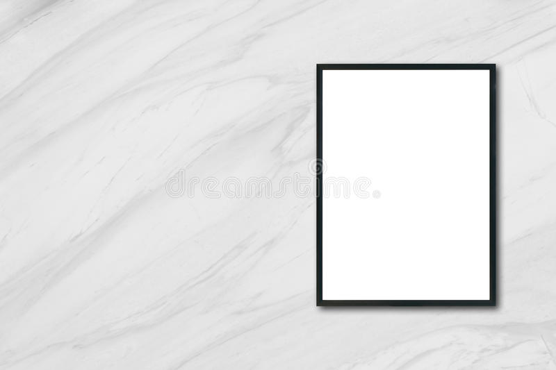 Mock up blank poster picture frame hanging on white marble wall in room. Mock up blank poster picture frame hanging on white marble wall in room - can be used stock photos