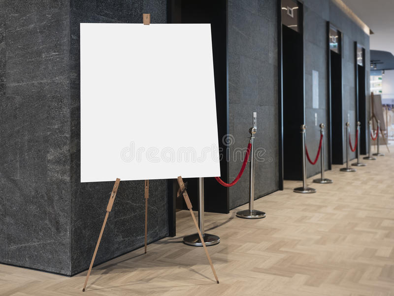 Mock up Blank Poster on stand Elevator indoor building stock images