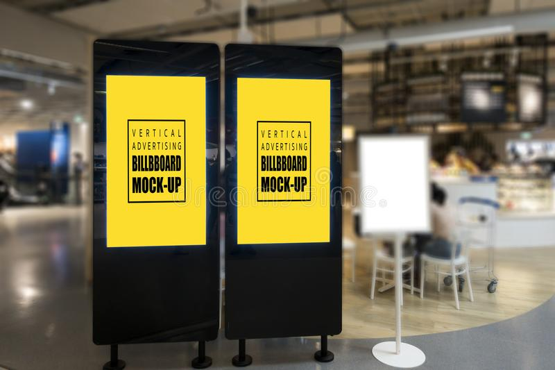 Mock up blank promotion poster display on black partition. Mock up two blank promotion poster display with clipping path on black partition in shopping mall royalty free stock photos