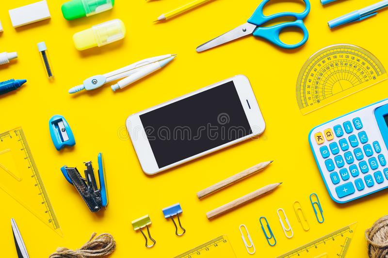 Mock up blank screen mobile phone for back to school background concept. School items background with copy space, top view flat. Lay background, above, agenda royalty free stock photo