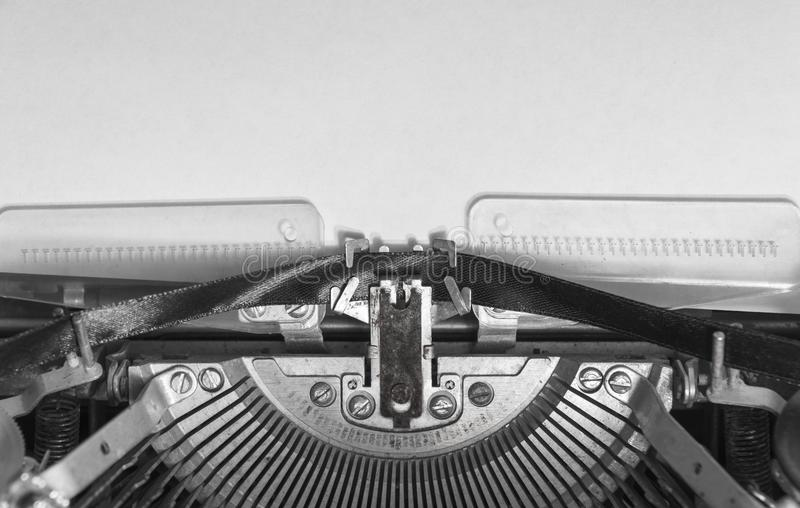 Mock up a blank sheet of paper in a vintage typewriter. stock images