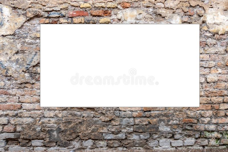 Mock up. Blank vertical billboard, poster frame, advertising on old brick wall. Mock up. Blank vertical billboard, poster frame, advertising on old brick wall stock photography