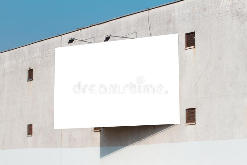 Mock up. Blank vertical billboard, poster frame, advertising on the the wall. royalty free stock photography