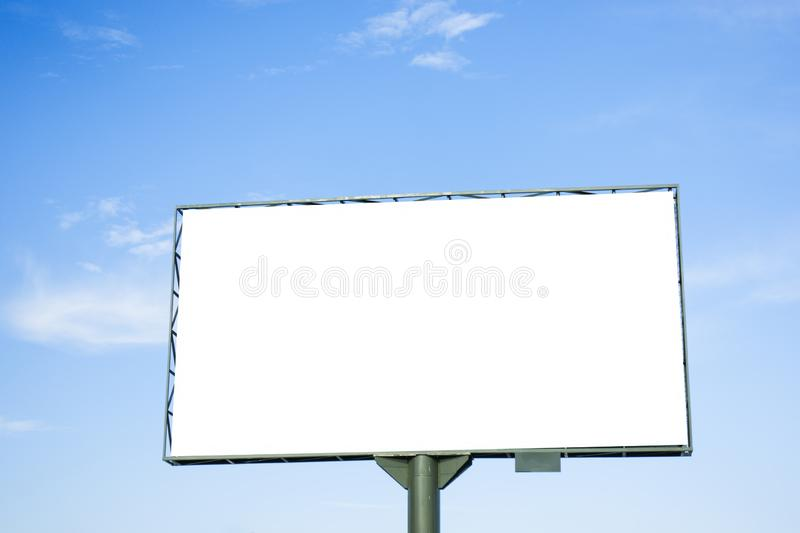 Mock up. Blank white billboard for outdoor advertising, marketing, sales against blue sky royalty free stock image