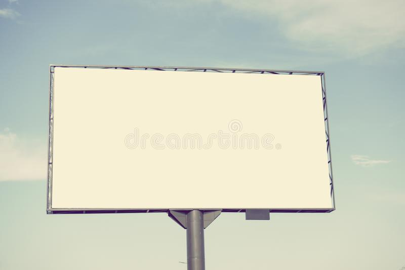 Mock up. Blank white billboard for outdoor advertising, marketing, sales against blue sky stock photos