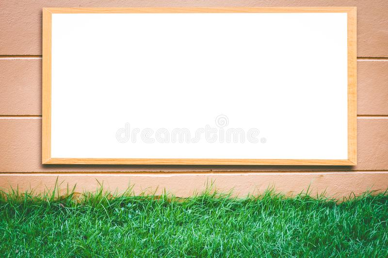 Mock up blank wooden picture frame on brick wall stock images