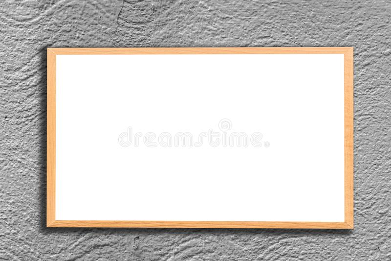 Mock up blank wooden picture frame on brick wall royalty free stock photography