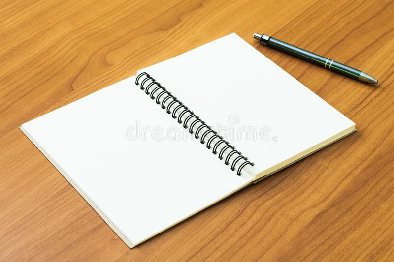 Mock up book open blank on desk wood stock images